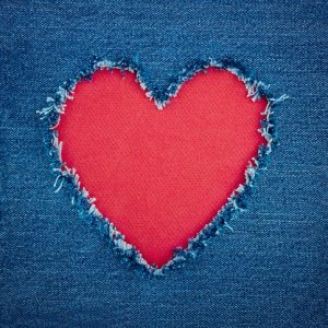 Blue denim background with red heart
