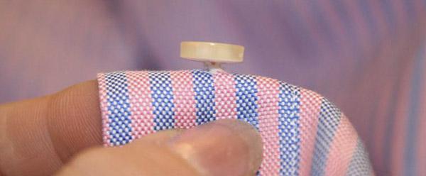 coser boton holgura