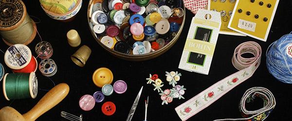 coser botones materiales